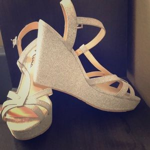 Silver sparkly wedges never worn.